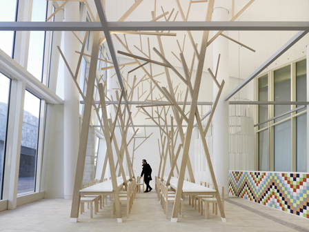 Trees used as table legs in contemporary canteen